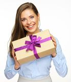 Happy woman holding paper gift box with violet ribbon. White back isolated Royalty Free Stock Photo