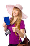 Happy woman is holding a passport with ticket Royalty Free Stock Photo
