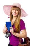 Happy woman is holding a passport with ticket Stock Photography