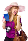 Happy woman is holding a passport with ticket Royalty Free Stock Photos