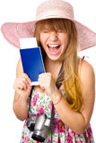 Happy  woman is holding a passport with ticket Stock Photos