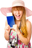 Happy  woman is holding a passport with ticket Royalty Free Stock Image