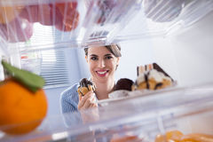 Happy woman holding pastry Royalty Free Stock Photography