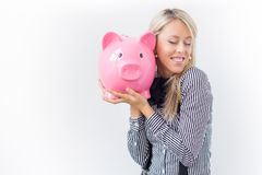 Happy woman holding piggy bank Royalty Free Stock Photos