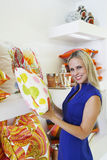 Happy Woman Holding Pillow In A Store Royalty Free Stock Photos