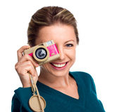 Happy woman holding pink camera on white background Stock Images