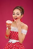 Happy Woman Holding Pink Doughnut. Pin-up retro Royalty Free Stock Images