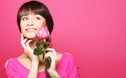 Happy woman holding pink rose Royalty Free Stock Photography