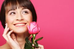 Happy woman holding pink rose Royalty Free Stock Photo