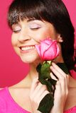 Happy woman holding pink rose Stock Photos