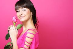 Happy woman holding pink rose Stock Image