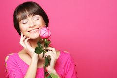 Happy woman holding pink rose Stock Photo