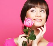 Happy woman holding pink rose royalty free stock photos