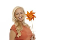 Happy woman holding pinwheel Stock Image