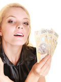 Happy woman holding polish currency money banknote. Royalty Free Stock Photo