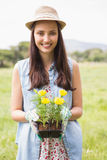 Happy woman holding potted flowers Royalty Free Stock Photos