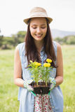 Happy woman holding potted flowers Royalty Free Stock Photo