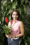 Happy Woman Holding Potted Plant Royalty Free Stock Images