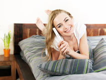 Happy woman holding pregnancy test Royalty Free Stock Photo