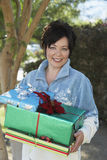 Happy Woman Holding Presents Royalty Free Stock Photography