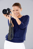 Happy woman holding a professional camera Royalty Free Stock Photos