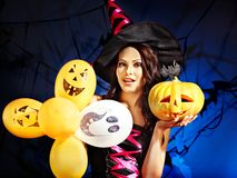 Happy woman holding pumpkin and balloon. Royalty Free Stock Photos