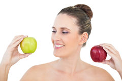 Happy woman holding red and green apple. On white background Stock Photo