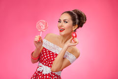 Happy Woman Holding red Lollipop. Pin-up retro Royalty Free Stock Images