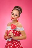Happy Woman Holding red Lollipop Shape of Heart Stock Photo