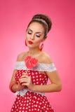 Happy Woman Holding red Lollipop Shape of Heart Stock Photo