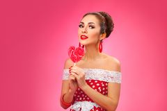 Happy Woman Holding red Lollipop Shape of Heart Stock Images