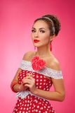 Happy Woman Holding red Lollipop Shape of Heart Stock Image