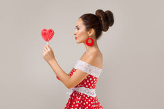 Happy Woman Holding red Lollipop Shape of Heart Royalty Free Stock Photos