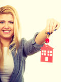 Happy woman holding red paper house and keys Royalty Free Stock Image