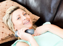 Happy woman holding a remote Royalty Free Stock Photo