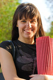Happy woman holding a rolled mat Royalty Free Stock Image