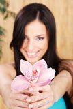 Happy woman holding rose orchid Royalty Free Stock Photo