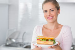 Happy woman holding sandwich Royalty Free Stock Photography