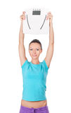 Happy woman holding  scale Royalty Free Stock Photography