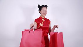 Woman holding shopping bag on chinese new year celebration stock video