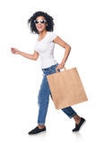Happy woman holding shopping bag with empty copy space running Royalty Free Stock Photos