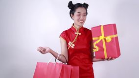 Woman holding shopping bag and red gift box in concept chinese new year celebration stock video