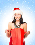 Happy woman holding a shopping bag on the snow Stock Photography
