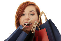 Happy woman  holding  shopping bags. Royalty Free Stock Photo