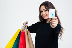 Happy woman holding shopping bags and bank card Royalty Free Stock Photos