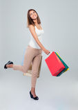 Happy woman holding shopping bags Stock Photography