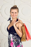Happy woman holding shopping bags Royalty Free Stock Image