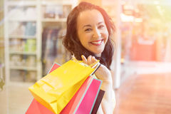 Happy woman holding shopping bags and smiling Royalty Free Stock Image