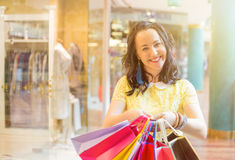 Happy woman holding shopping bags Royalty Free Stock Photography