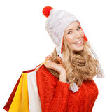 Happy woman holding shopping  bags. Winter sales. Isolated. Royalty Free Stock Image